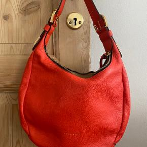 Never used bag. Adjustable belt. Trendy coral red colour.