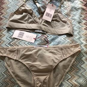 Stella Lingerie set in size medium. Soft cup bra with racer back and mesh underwear. Check out my other listings with Stella McCartney too.