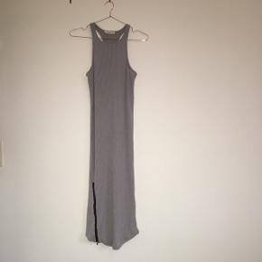 Grey knitted tight fit dress with zipper detail. Never used. Brand is DOUBLE ZERO and was purchased in Canada.