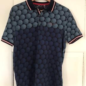 Ted Baker golf polo shirt til mænd. Str. 4   Brugt godt, men stadig brugbar.