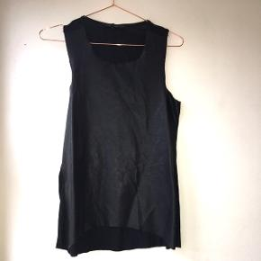 Black faux leather top with black stretchy fabric back. Brand is Olivaceous and was purchased in Canada.