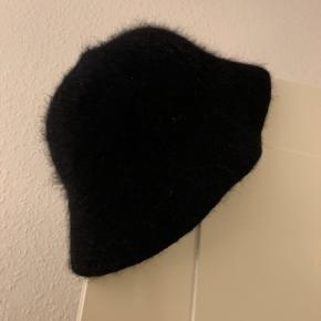 Sød hat i angora uld, varm, fra smilende Sussi brugt 2 gange.