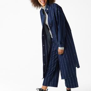 Long coat from Monki. I usually wear medium but this XS fits perfect.