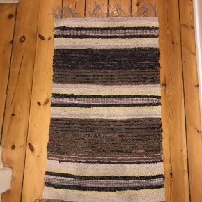 Beautiful handmade Swedish rug for sale. Measures 102 x 60cm. Multicolored with purple, yellow and blue accents. No shipping must pick up!  Accepting BYDS