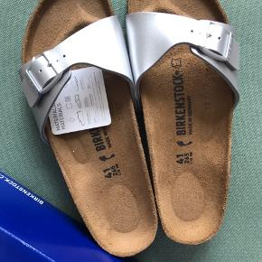 New Birkenstock sandals size 41 narrow fit. I bought them and can't return them (I forgot). Never ever used, still with the tag and in its original box.