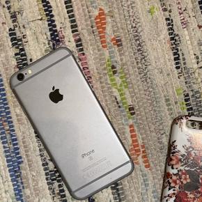 Lækker IPhone 6s med 128 GB Et par ridser på skærmen og home-knappen virker ikke. Men det kan laves billigt