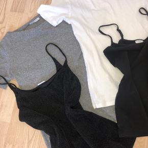 """Basic overdele fra Zara, Jacqueline de Young og Benetton.   Den hvide t-shirt, sorte top og glimmer top er str xs, den grå """" ribstrikket"""" t-shirt er str M, men lille i størrelsen.  Noget er som nyt, andet er mere brugt. Prisen er for alle 4 :)"""