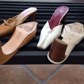 Heels i super kvalitet - ægte skind og med lædersål. Den lyse er fra Ecco og er str. 6.5 den mørke er fra Schnoor og er str. 6. Prisen er pr. Par.