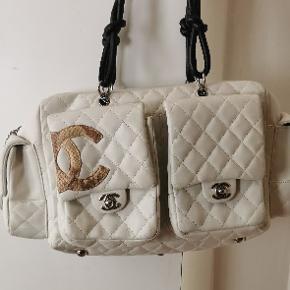Chanel reporter med CC slangeskind. Jeg sælger pga manglepenge .
