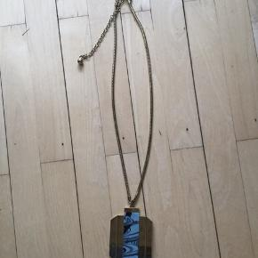 Statement piece of jewelry,  no scratches. missing the belt part of  chain that goes around the waist.