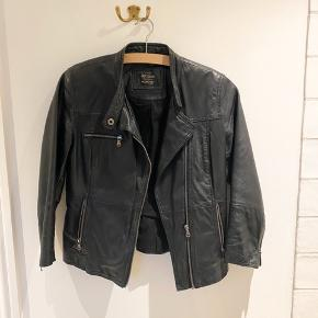 Leather biker jacket with zipper. Used for a short time but In very good condition. 3/4 length sleeves
