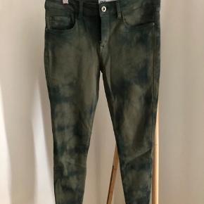 Khaki batik elastic pants. Skinny pants. High waist. Size 36. Never used!