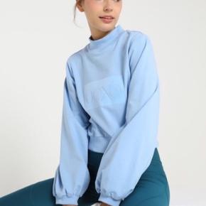 Hunkemöller sweatshirt i den flotteste blå farve. Kun brugt en enkel gang.