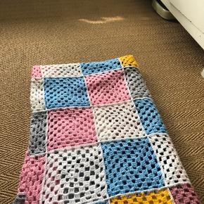 Tæppe i pastelfarver  Ingen tegn på slid