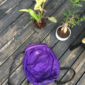 Purple Sports Foldable QUECHUA Backpack for hiking, trekking, or also everyday use.  Waterproof. Foldable.   Great condition, like new.