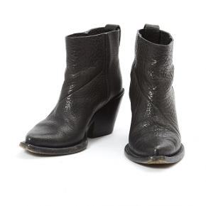 Acne boots in very good condition. Only used a few times.  Cowboy boots in black grained leather with pointed toe and Cuban heel. Sold without packaging. Note: Bottom of the sole and heels have gotten rubber-soles for better protection and stability by a shoe maker.  Size: 38