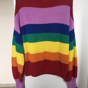 Super fin multifarvet strik sweater med ballonærmer, rund hals og ribkanter fra Monki med striber i forskellige kraftige farver bl.a. rød, gul, grøn, blå og lilla. Str. M. Kom med et bud. NP: 300kr.  Varen befinder sig i 9520 Skørping. Sender med DAO.  Se også min øvrige annoncer. Jeg sælger tøj, sko og accessories. Pt er min shop fuld af vintagekup, high street fund og mærkevarer i mange forskellige str. Kig forbi og spøg endelig!!