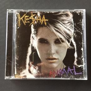 Kesha Animal cd musik  1	Stephen 2	Your Love Is My Drug 3	TiK ToK (Wolfedelic Club Mix) 4	Blah Blah Blah [Explicit] 5	TiK ToK (Fred Falke Club Remix) 6	c u next tuesday [Explicit] 7	Dinosaur 8	Backstabber [Explicit] 9	Kiss N Tell 10	Blind 11	Party At A Rich Dude's House [Explicit] 12	Take It Off 13	TiK ToK 14	Boots & Boys 15	VIP 16	Dancing With Tears In My Eyes 17	Animal 18	Hungover