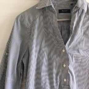 Lang skjorte. Helt som ny. Ærmerne er trekvarte. Skulder og ned 86 cm. Brystvidde 53*2 cm.