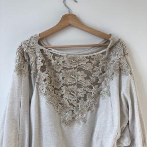 Anthropologie lace détail sweater in excellent condition. Note that the first photo is actually of the back of the sweater with the lace detail. Check out my other listings for a bundle discount!