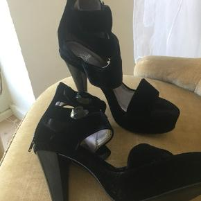 Heel 10.5 Platform sole 4cm   Only wore them one time. They are extremely comfortable and have stability because of the platform. The velvet material gives them a very elegant look