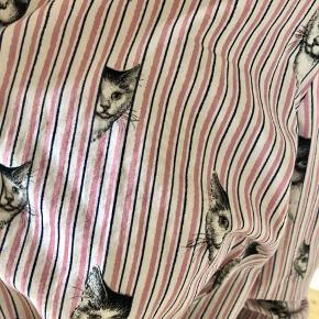 Katteskjorte. Brugt to gange