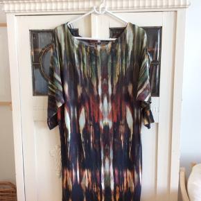 Kjolen er købt i Stine & Ko. Mærket er Créme de la Créme