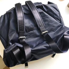 Arket Backpack in flawless condition. It hasn't been used at all and therefore has no defects or other problems. The original price is 890 DKK. It's made from durable nylon material which is waterproof and perfect to use when biking. It has three compartments inside two additional ones outside the bag. (As shown on pictures) Also a good bag to travel with since it's super spacious and easy to carry.  In the Description Tag on the inside of the bag it says it's a bag from the women's department but I think it's quite unisex and can be worn by everyone.