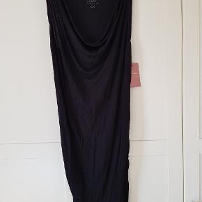 Lækker kjole. Der står xxs i den, men den er stor i str., så passer en xs/s.