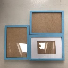 Three picture frames, sprayed blue for an exhibition. You can see damage, with the black layer underneath becoming visible but they're still quite beautiful.