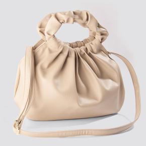 Na-kd håndtaske