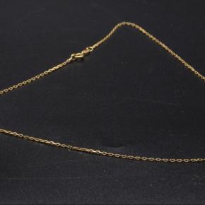 Halskæde udført i 14 kt. guld, ankermønster.   L. 37 cm.   Vægt ca. 1,4 gram.  Ny og ubrugt