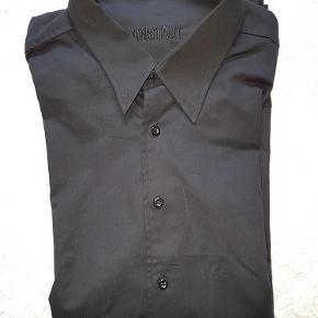 Varetype: Skjorte str XL sort Kronstadt kr.75 Farve: Sort Oprindelig købspris: 250 kr.  Str XL Skjult buttom down under flip (se foto).