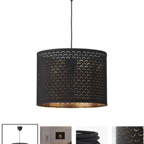 Lampeskærm i sort og guld. I fin stand.