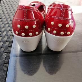 En behagelig rød sko i Tod's mærke