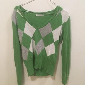 Fin grøn trøje, med et rigtig clueless Vibe. Byd gerne