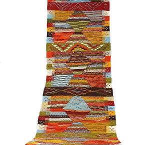 Løber i uld, måler 250 x 65 cm. Er Håndlavet, har aldrig været brugt.