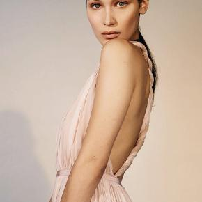 Unused and undamaged Greek style nude pink dress ala Bella Hadid. Size 38/M. Multiple layers in the skirt and not see-through.