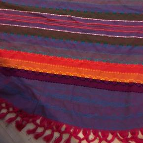 Handmade from Mexico - can be used at the beach, in the living room as a cover or on the floor as a light carpet!  Cool colors :)