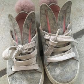 Minna Parikka Bunnies; grey soft leather. Size 25. Used for one season. The bunny tails are a bit loose, but not falling off. Cost 1800DKK as new.  100% genuine and post fee paid by me.