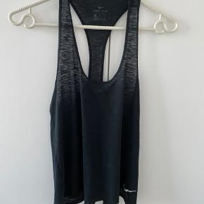 Nike tops for running or training, short style, fits size S-M. Good condition.