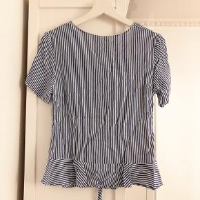 A cute stripy top by H&M. Only worn a few times, in great condition.