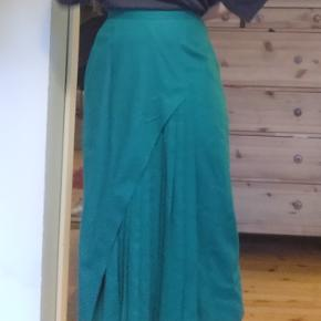 Vintage green wool skirt. I have never worn it because it is slightly too big for me. It is a waist high skirt. I bought it in a vintage store in Canada