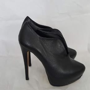 Brand new, unused, unworn, undamaged black leather premium stiletto booties from Pre/ Fall collection. Rare and sold out.
