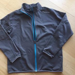 Skøn jakke med detaljer i turkis