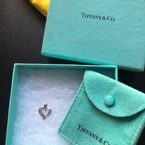 White Gold heart pendent. From Tiffany's with box and holder. Perfect condition.