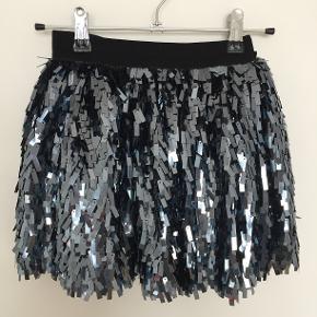 Palliet nederdel med elastik i taljen.