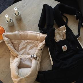 Ergobaby bæresele inkl. babyindsats til de første måneder. Fremstår næsten helt ny.