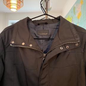 Weather resistant jacket from a comfortable material with nice details. On sides has stretchy patches that will help the jacket perfectly adjust your body. Size L but great for people used to both M/L size