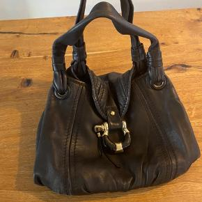Jimmy Choo bag. Leather looks good, inside has stains.